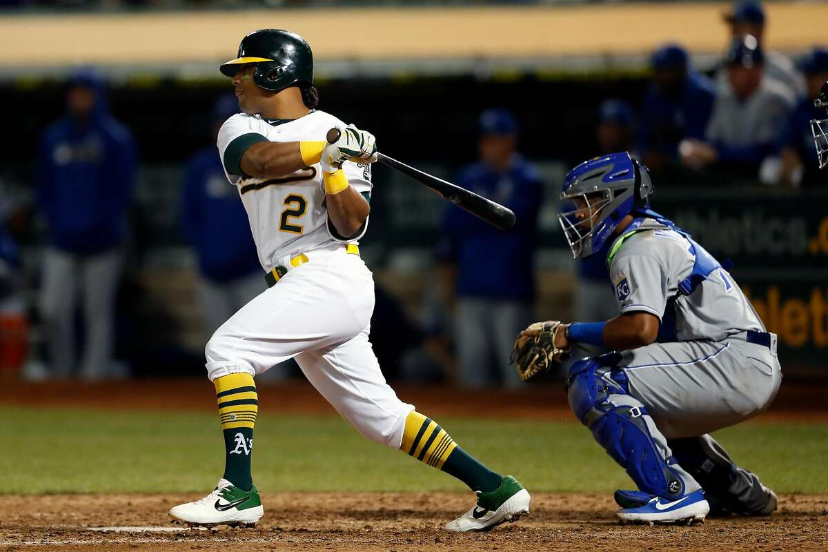 Oakland Athletics' Khris Davis watches his RBI single give A's a 5-4 lead in 8th inning against Kansas City Royals during MLB game at Oakland Coliseum in Oakland, Calif., on Monday, September 16, 2019.