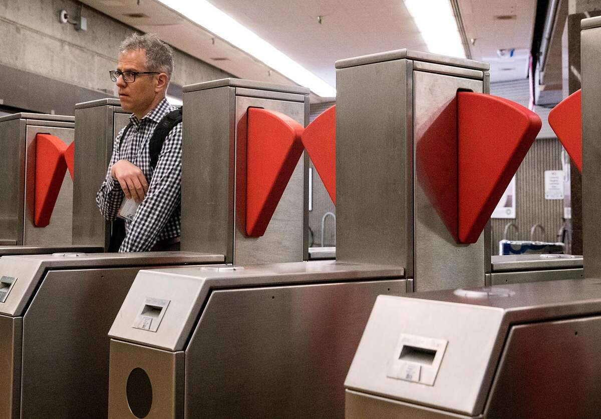 Commuters make their way through a new prototype fare gate at the Richmond BART Station in Richmond, Calif. Tuesday, July 9, 2019.