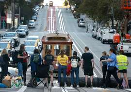 Protesters blocking traffic on California Street as part of the Global Climate Strike in San Francisco on Sept. 25, 2019. Physicians Ashley McClure and Amanda Millstein argue that climate change is a public health emergency.