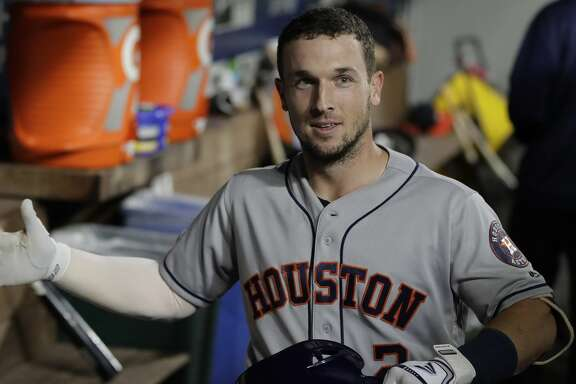 Houston Astros' Alex Bregman reacts in the dugout after hitting a solo home run during the fourth inning of the team's baseball game against the Seattle Mariners, Tuesday, Sept. 24, 2019, in Seattle. (AP Photo/Ted S. Warren)