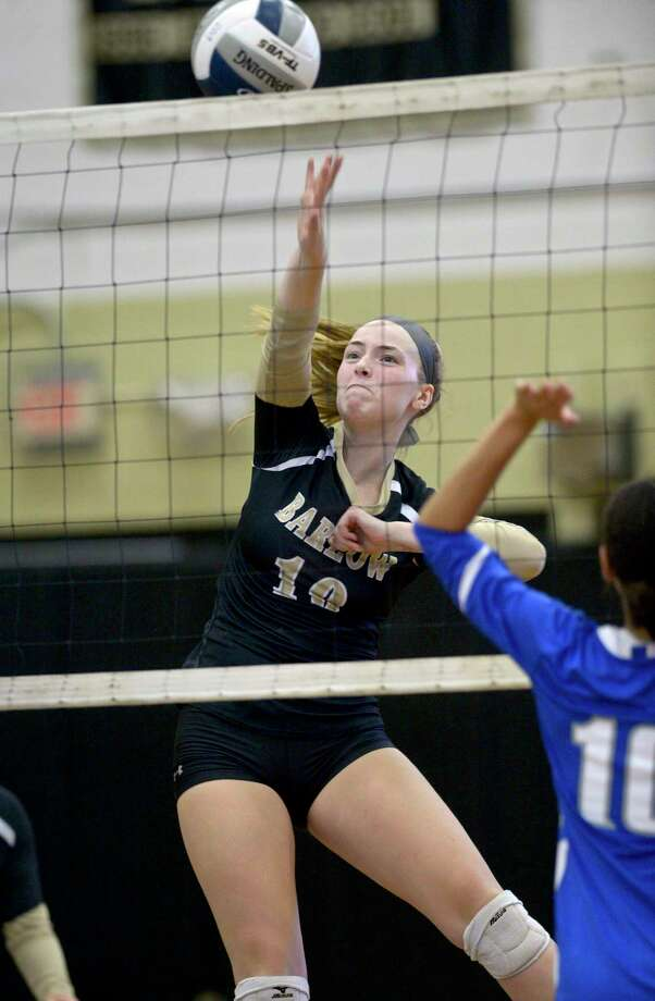Joel Barlow's Grace Gilmore (10) spikes the ball for a point in the girls volleyball match between Bunnell and Joel Barlow high schools, Wednesday afternoon, September 25, 2019, at Joel Barlow High School, Redding, Conn. Photo: H John Voorhees III / Hearst Connecticut Media / The News-Times