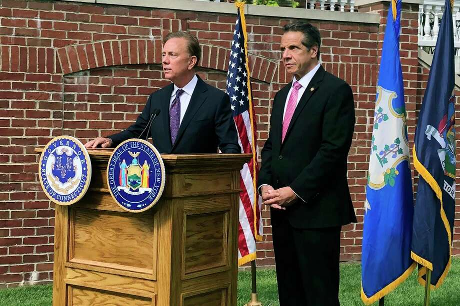 Connecticut Gov. Ned Lamont, left, speaks as New York Gov. Andrew Cuomo listens during a press conference, Wednesday, Sept. 25, 2019, in Hartford, Conn. Photo: Susan Haigh / Associated Press / Copyright 2019 The Associated Press. All rights reserved.