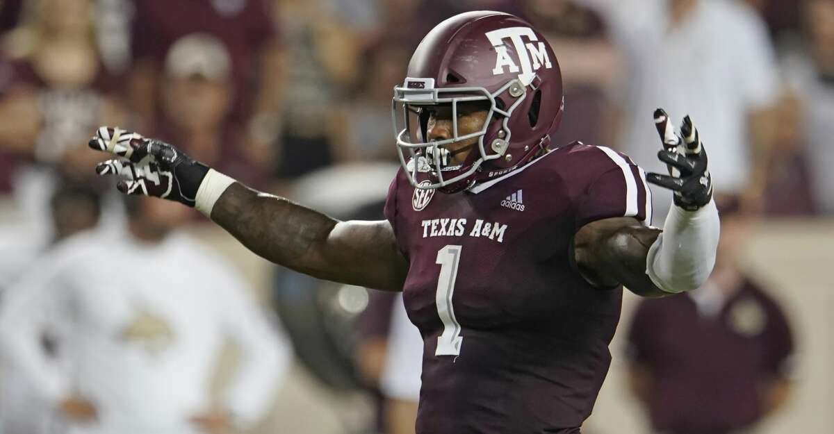 Texas A&M's Buddy Johnson (1) looks against against the Texas State offense during the second half of an NCAA college football game in College Station, Texas, Thursday, Aug. 29, 2019. (AP Photo/Chuck Burton