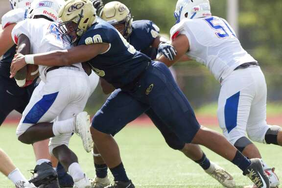 Klein Collins defensive linemen Cornelius Campbell (90) tackles Oak Ridge quarterback Kavon Townsend (3) during the first quarter of a District 15-6A high school football game at Klein Memorial Stadium, Saturday, Sept. 21, 2019, in Spring.