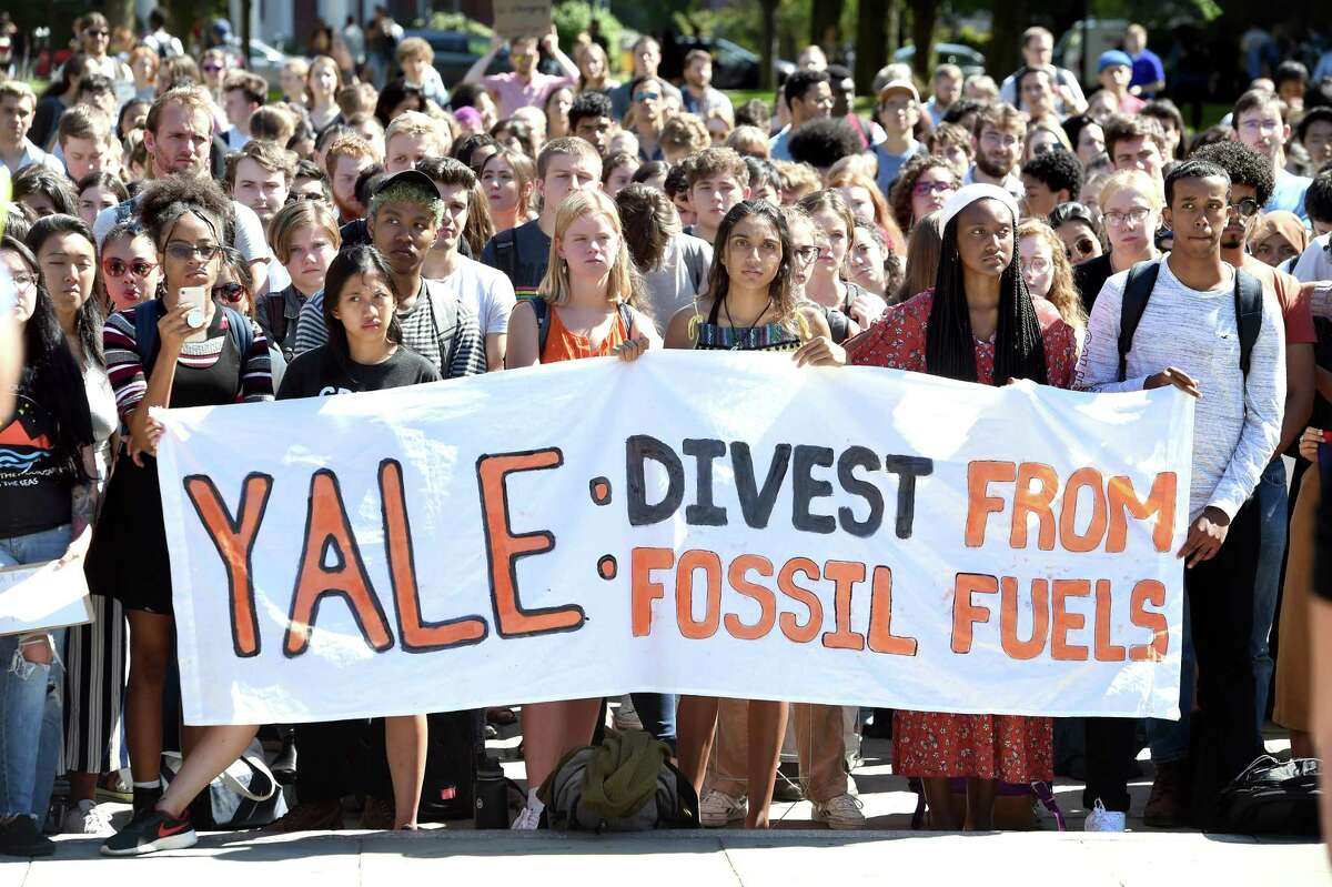 Yale University students and faculty protest on Cross Campus during the Yale Climate Strike to protest Yale's investments in the fossil fuel industry and the holdings in Puerto Rican debt on September 25, 2019.