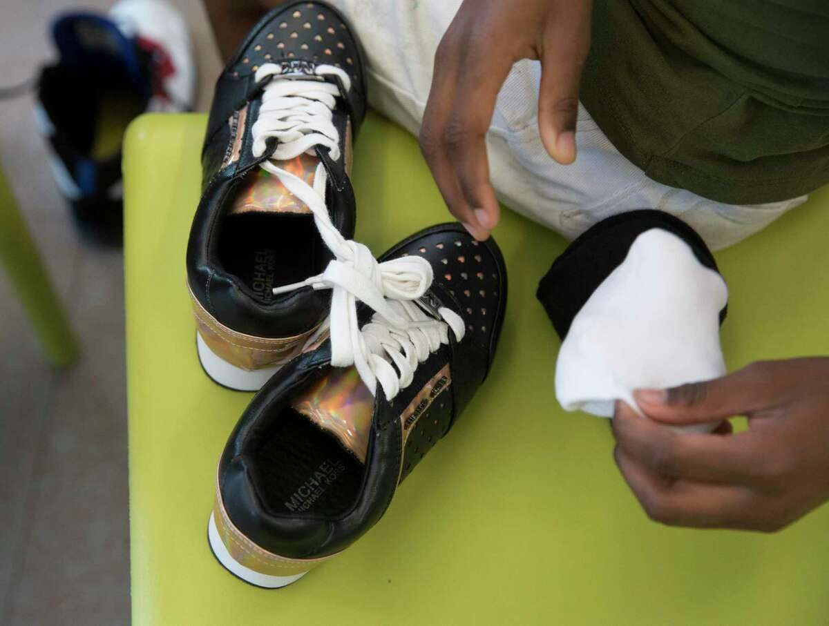 Kids living at the new Women & Family Development Center at Star of Hope's Cornerstone Community pair up with volunteers to find a pair of shoes to start the 2019-2020 school year in Houston. At this event, more than 150 homeless children received a pair of shoes. The Houston metro region's poverty rate increased in 2018 to 14.3 percent, according to Census data released Thursday.