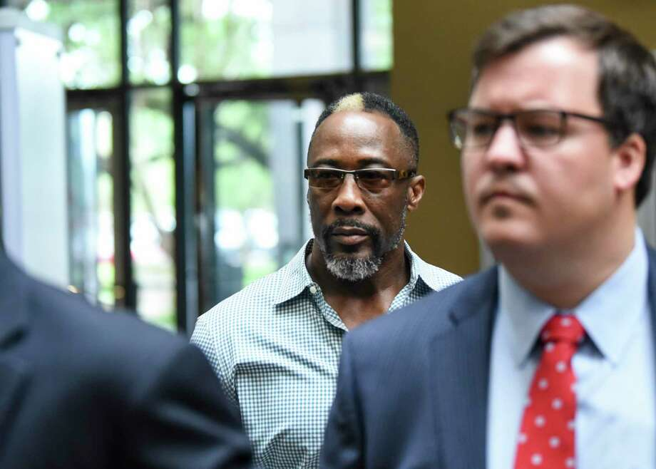 Calvin Walker walks out of the jury empaneling room during jury selection in his case at Jefferson County Courthouse Monday afternoon. Walker is facing a felony after allegedly overcharging BISD for electrical work in 2009. Photo taken on Monday, 09/16/19. Ryan Welch/The Enterprise Photo: Ryan Welch, Beaumont Enterprise / The Enterprise / © 2019 Beaumont Enterprise