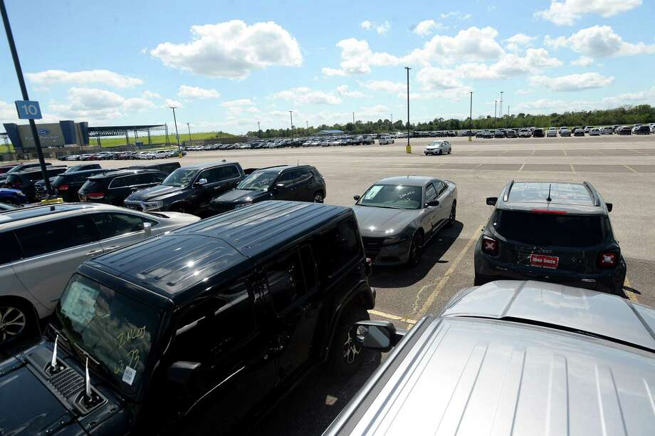 Mike Smith dealership flood-impacted vehicles fill the parking lot at Ford Park Wednesday after having been towed from the various dealerships starting Tuesday.  Photo taken Wednesday, September 25, 2019 Kim Brent/The Enterprise Photo: Kim Brent / The Enterprise / BEN
