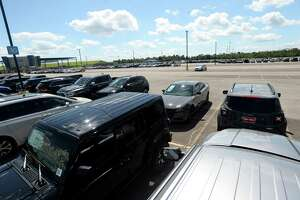 Mike Smith dealership flood-impacted vehicles fill the parking lot at Ford Park Wednesday after having been towed from the various dealerships starting Tuesday.  Photo taken Wednesday, September 25, 2019 Kim Brent/The Enterprise
