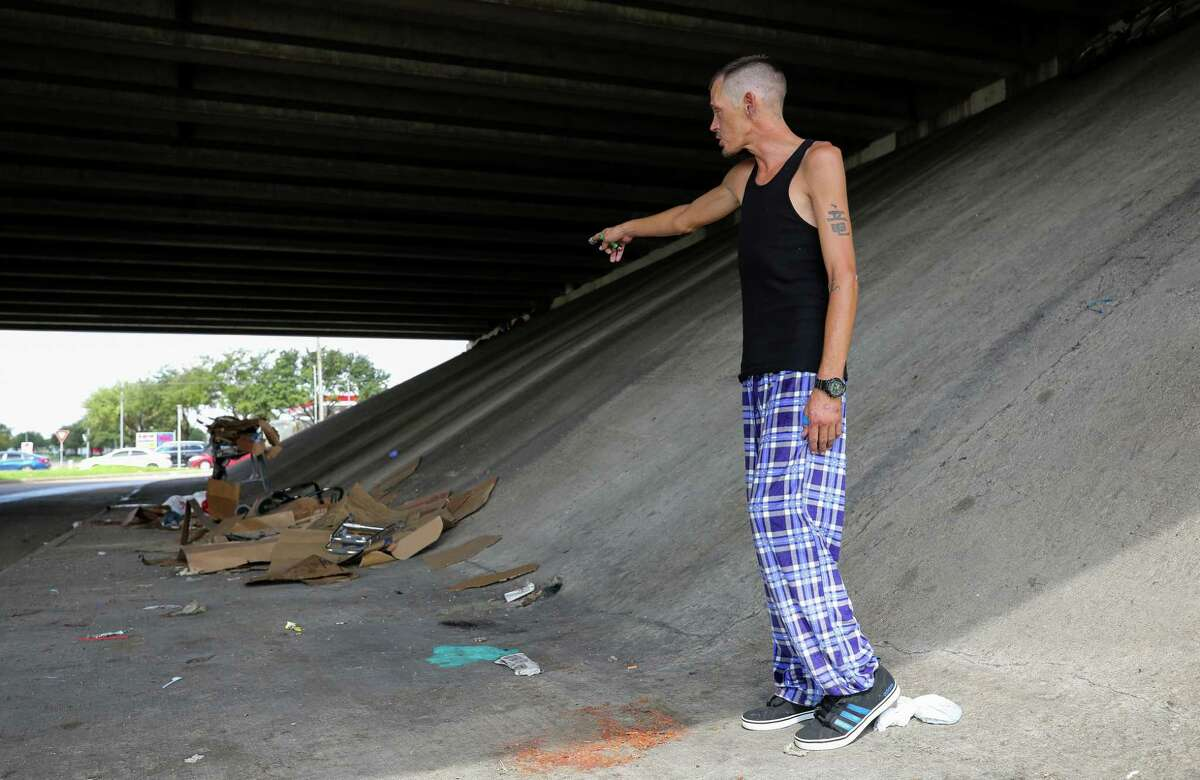 Michael Phillips talks about the vehicle crash that killed a couple in their 60s, whom had been evicted recently and were living under the Sam Houston Tollway overpass, at Beechnut Street Wednesday, Sept. 25, 2019, in Houston. According to Phillips, the couple had two service dogs as well.