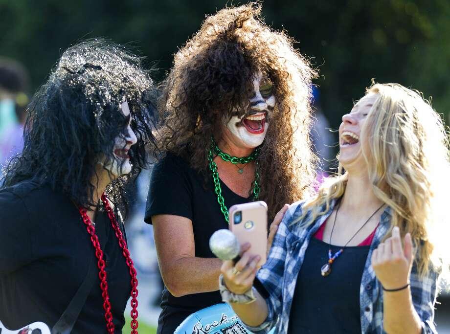 Oak Ridge softball coaches Stephani Rougeau and Tara Megilligan shares a laugh with Emily Lyons before the Oak Ridge High School homecoming parade, Wednesday, Sept. 25, 2019. Photo: Jason Fochtman/Staff Photographer