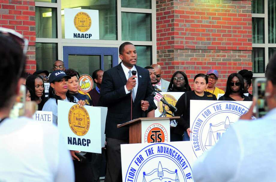 State Senator George Logan speaks during a rally held by the NAACP before the start of the Shelton Board of Education meeting at Shelton Intermediate School on Sept. 25. The Valley NAACP President Greg Johnson, Sr. says the school's reaction was inadequate after two middle school children dressed up in blackface recently. Photo: Christian Abraham / Hearst Connecticut Media / Connecticut Post