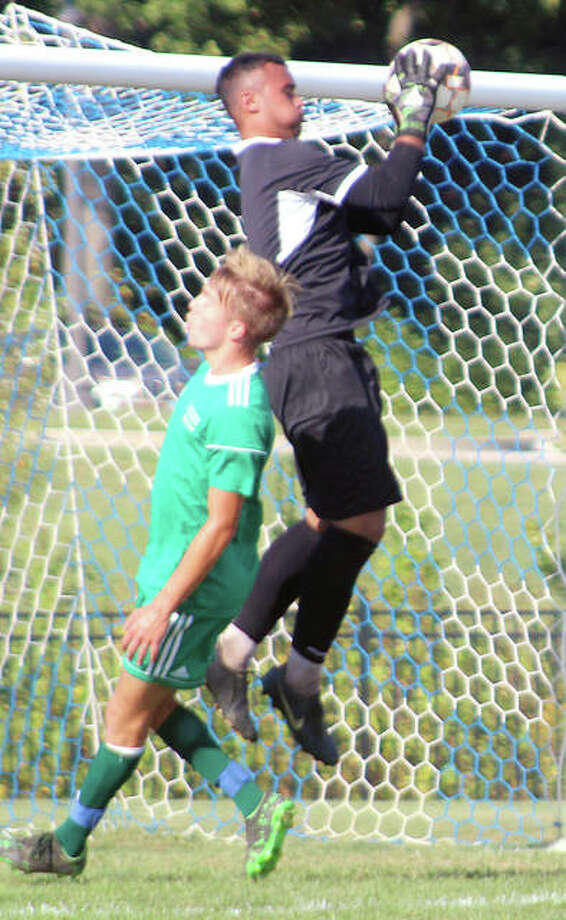 LCCC goalie Christian Deans grabs a a crossing pass intended for Jan Luca Behnke of John Wood College during Wednesday's game at LCCC's Tim Rooney Stadium. Deans made seven saves and helped the No. 20-ranked Trailblazers notch their second shutout of the season.