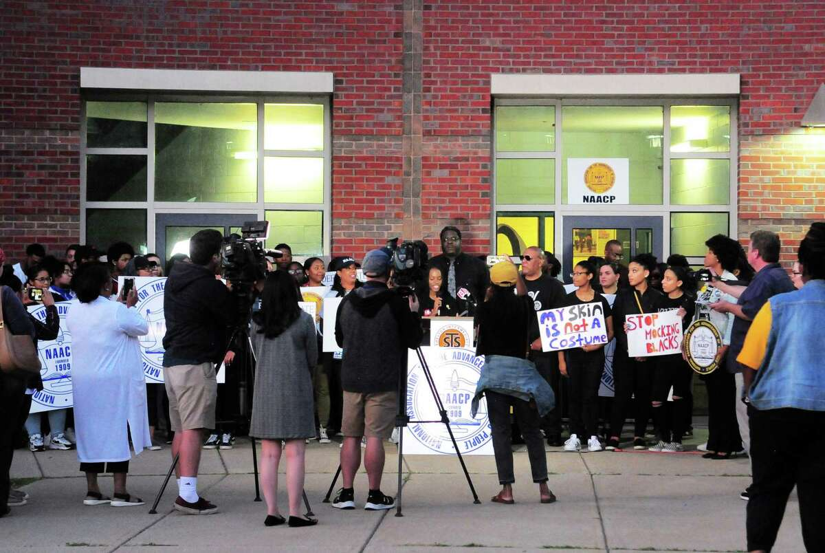 State and local chapters of the NAACP hold a rally before the start of the Shelton Board of Education meeting at Shelton Intermediate School on Sept. 25.