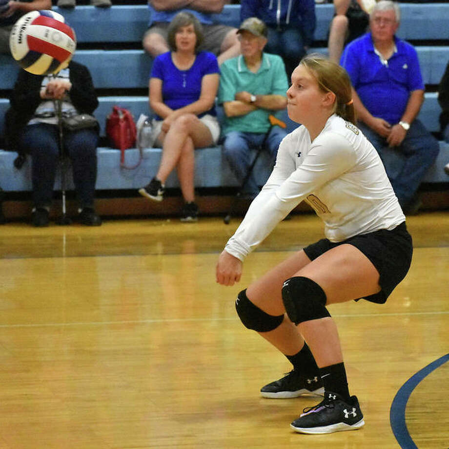 Father McGivney libero Macy Hoppes handles a serve in the first game against Marquette in Alton on Wednesday.