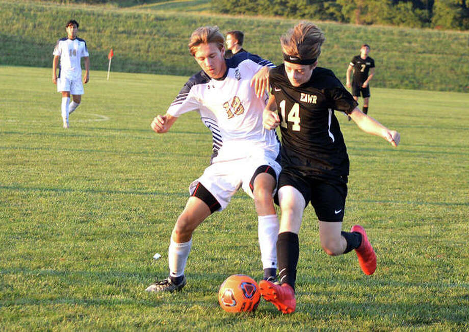 Father McGivney's Nick Lacy, left, and East Alton-Wood River's Lucas Moore go after the ball during Wednesday's game at Wood River Soccer Park. Photo: Scott Marion/The Intelligencer