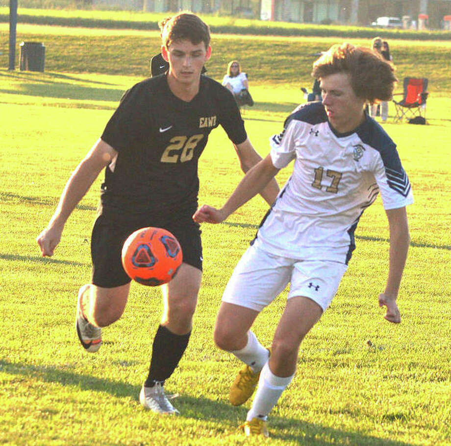 Father McGivney's Kellen Weir, right, and East Alton-Wood River's Jake Wells battle for the ball during Wednesday's game at Wood River Soccer Park. Photo: Scott Marion / Hearst Illinois