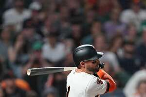 SAN FRANCISCO, CALIFORNIA - SEPTEMBER 25: Kevin Pillar #1 of the San Francisco Giants hits an rbi single scoring Mauricio Dubon #19 against the Colorado Rockies in the bottom of the third inning at Oracle Park on September 25, 2019 in San Francisco, California. (Photo by Thearon W. Henderson/Getty Images)