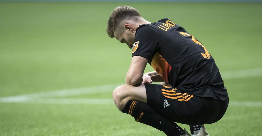 Houston Dynamo's Adam Lundkvist pauses on the field after Houston was defeated by the Vancouver Whitecaps during an MLS soccer match in Vancouver, on Saturday Sept. 14, 2019. (Darryl Dyck/The Canadian Press via AP) Photo: Darryl Dyck/Associated Press