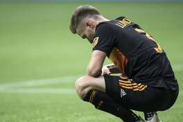 Houston Dynamo's Adam Lundkvist pauses on the field after Houston was defeated by the Vancouver Whitecaps during an MLS soccer match in Vancouver, on Saturday Sept. 14, 2019. (Darryl Dyck/The Canadian Press via AP)