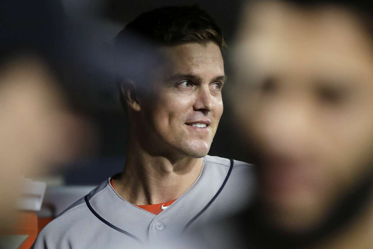 Houston Astros starting pitcher Zack Greinke smiles as he looks out from the dugout before heading out to pitch against the Seattle Mariners during the ninth inning of a baseball game Wednesday, Sept. 25, 2019, in Seattle. The Astros won 3-0. (AP Photo/Elaine Thompson)