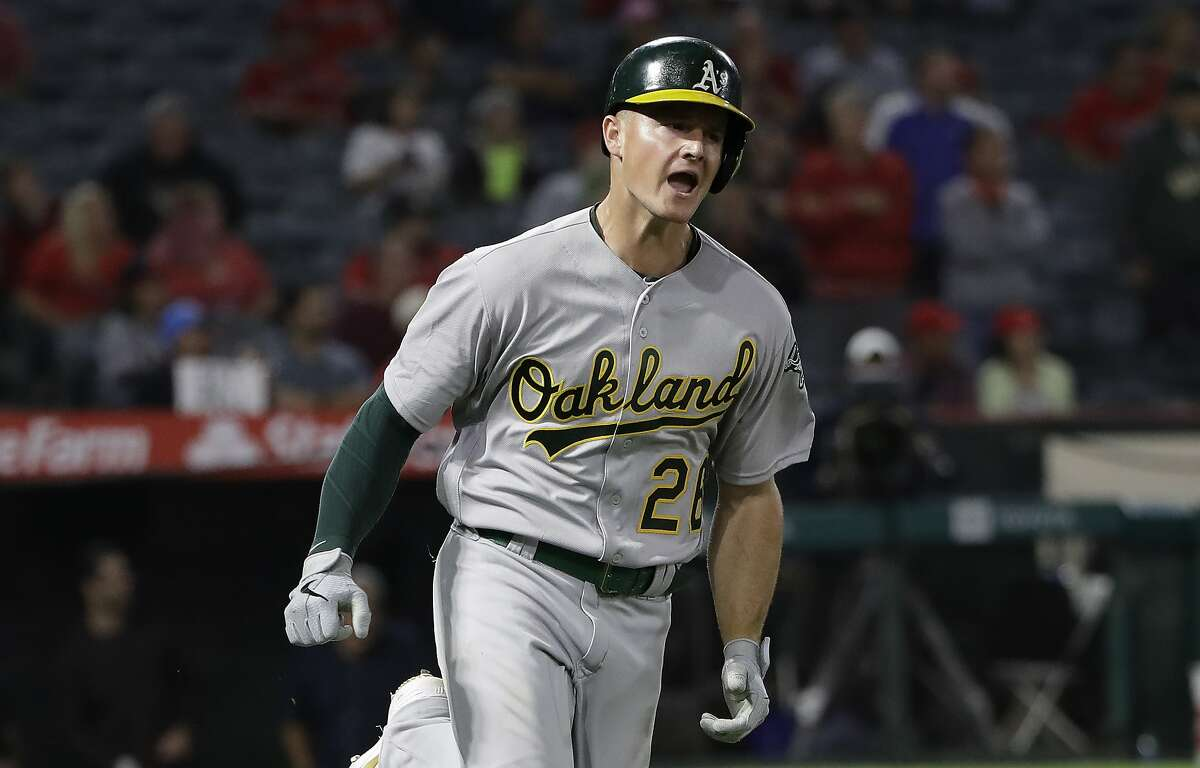 Oakland Athletics' Matt Chapman celebrates as he rounds first base on a two-run home run against the Los Angeles Angels during the ninth inning of a baseball game Wednesday, Sept. 25, 2019, in Anaheim, Calif. (AP Photo/Marcio Jose Sanchez)