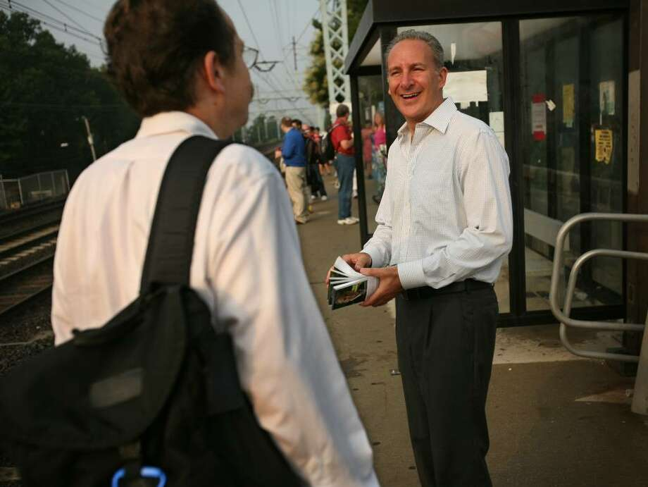 Peter Schiff of Weston, a candidate in the Republican primary for the U.S. Senate seat being vacated by Christopher Dodd, campaigns at the Stratford train station on Thursday August 5, 2010. Photo: Brian A. Pounds / Connecticut Post