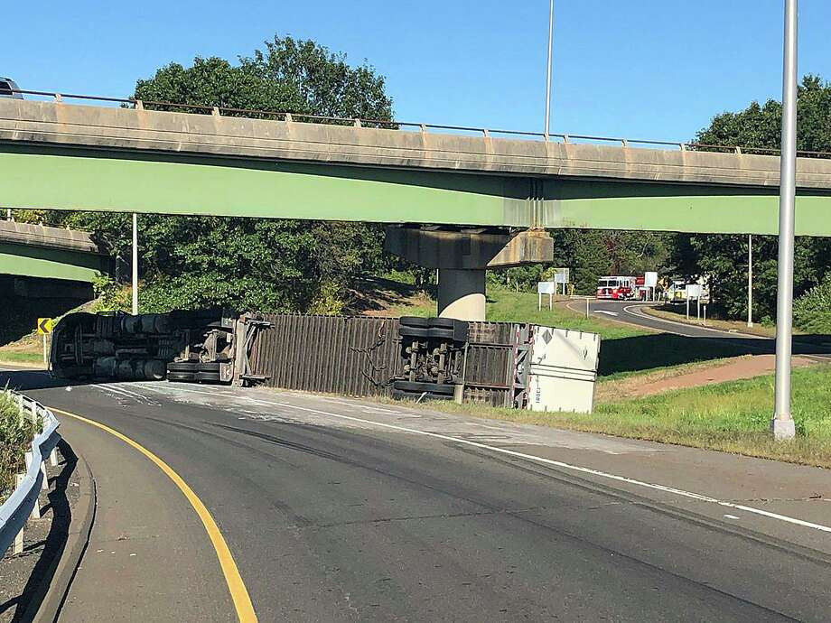 An overturned tractor-trailer the Route 40 southbound ramp to Interstate 91 was closed for several hours on Wednesday, Sept. 25, 2019 because of an overturned truck. Photo: North Haven Fire Department Photo