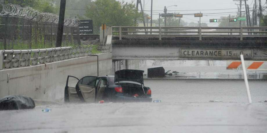 Flooded out cars and debris sit on 4th Street near the train overpass in Beaumont where several roads remained heavily flooded throughout the afternoon. Boaters and other emergency personnel were conducting rescue missions to those in need throughout the morning and afternoon. Photo taken Thursday, September 19, 2019 Kim Brent/The Enterprise Photo: Kim Brent / The Enterprise / BEN