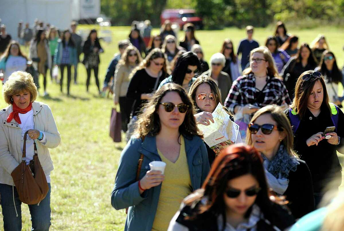 Participants in first day of the three-day Gilmore Girls Fan Fest in Kent, look for the next activity on Friday's schedule of events Oct. 20, 2017.