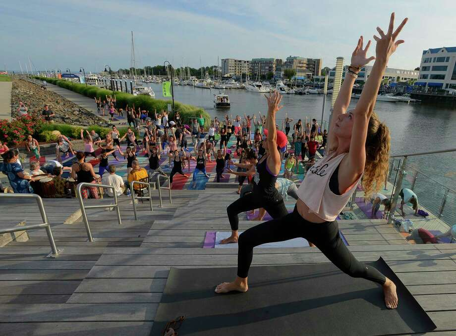 Shannon Carlin of Bridgeport, along with 50 yoga enthusiasts participate in the 5th annual Yoga Jam 2017 at Harbor Point Boardwalk on Friday, July 21, 2017 in Stamford, Connecticut. The event was co-sponsored by lululemon Greenwich and Exhale Spa, where Carlin is an instrutor. Photo: Matthew Brown / Hearst Connecticut Media / Stamford Advocate
