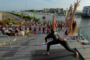 Shannon Carlin of Bridgeport, along with 50 yoga enthusiasts participate in the 5th annual Yoga Jam 2017 at Harbor Point Boardwalk on Friday, July 21, 2017 in Stamford, Connecticut. The event was co-sponsored by lululemon Greenwich and Exhale Spa, where Carlin is an instrutor.