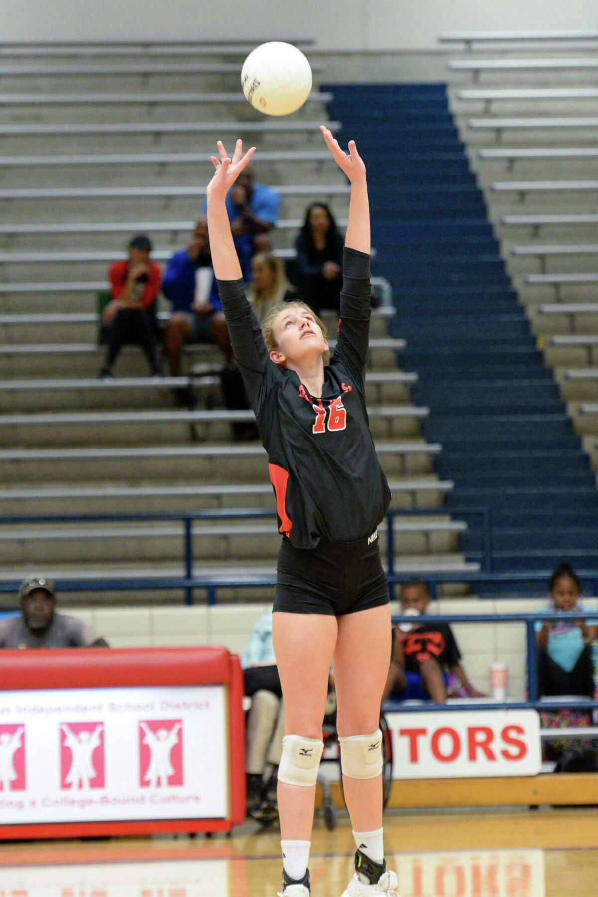 Piper Stephenson (16) of Bellaire sets a ball during the second set of a high school volleyball match between the Bellaire Cardinals and the Chavez Lobos on Tuesday, September 24, 2019 at Butler Fieldhouse, Houston, TX.