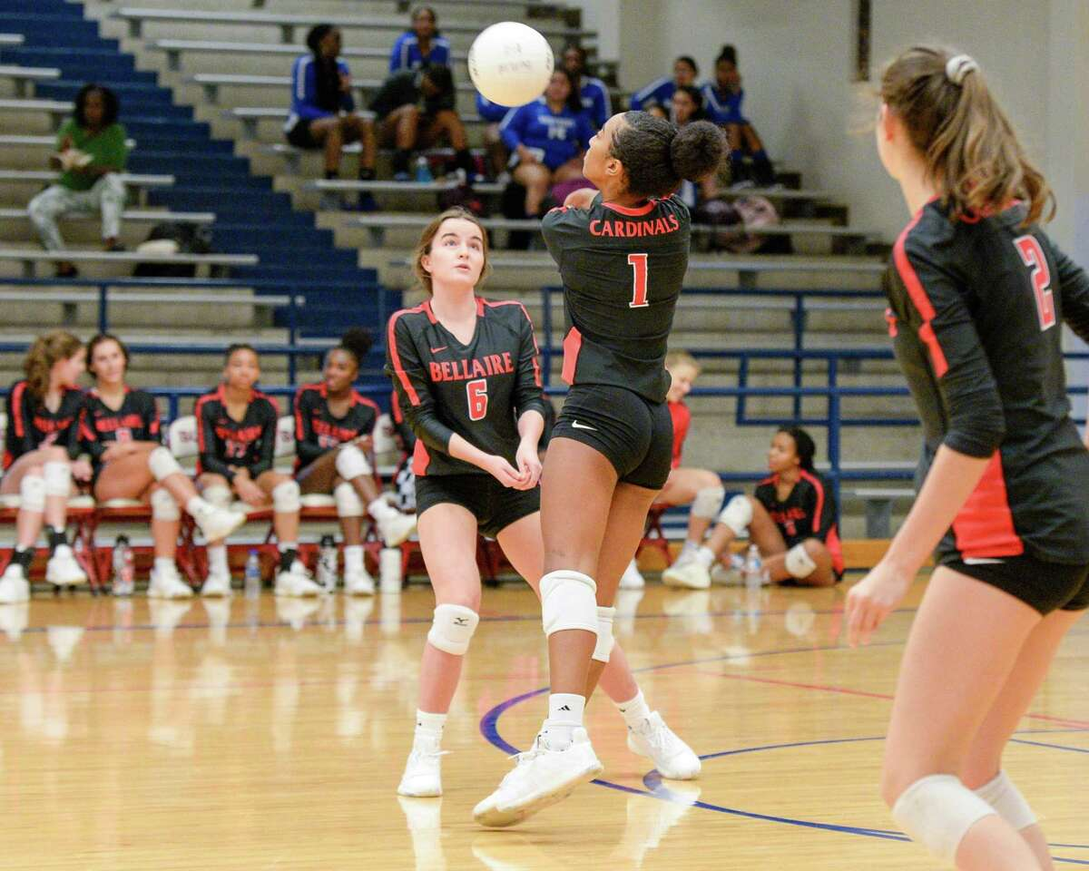 Nylah Raspberry (1) of Bellaire digs for a ball during the second set of a high school volleyball match between the Bellaire Cardinals and the Chavez Lobos on Tuesday, September 24, 2019 at Butler Fieldhouse, Houston, TX.