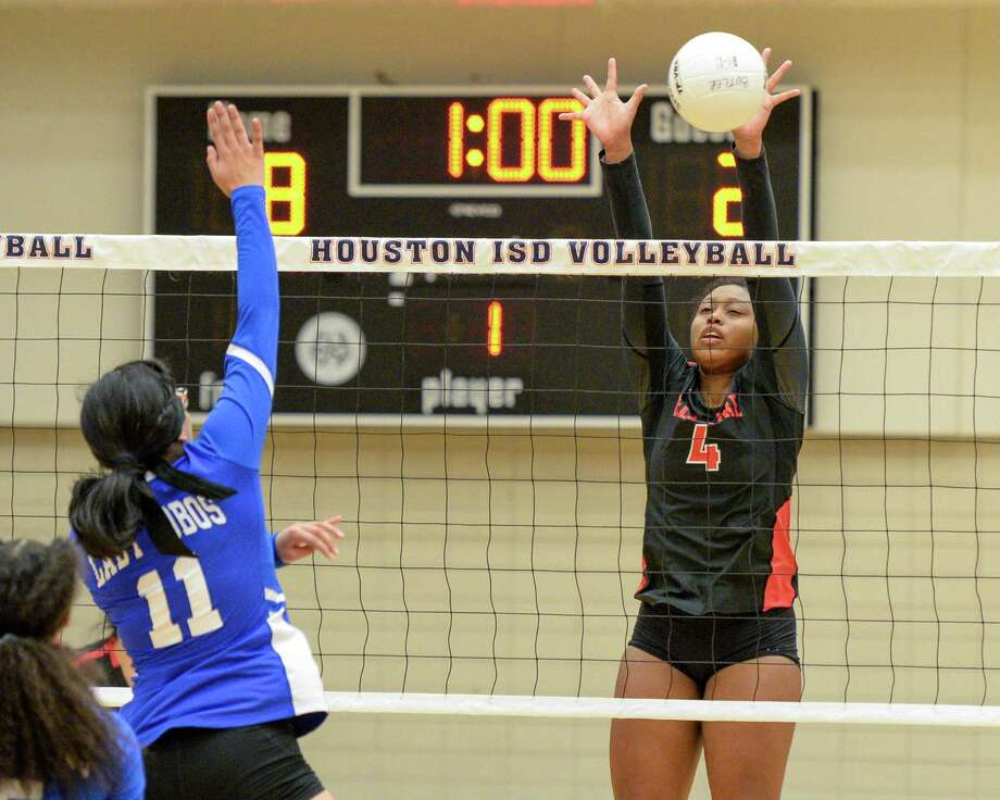 Armyni Perales (4) of Bellaire blocks the shot of Jennifer Gervantes (11) of Chavez during the second set of a high school volleyball match between the Bellaire Cardinals and the Chavez Lobos on Tuesday, September 24, 2019 at Butler Fieldhouse, Houston, TX. Photo: Craig Moseley, Staff / Staff Photographer / ©2019 Houston Chronicle