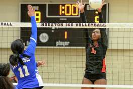 Armyni Perales (4) of Bellaire blocks the shot of Jennifer Gervantes (11) of Chavez during the second set of a high school volleyball match between the Bellaire Cardinals and the Chavez Lobos on Tuesday, September 24, 2019 at Butler Fieldhouse, Houston, TX.