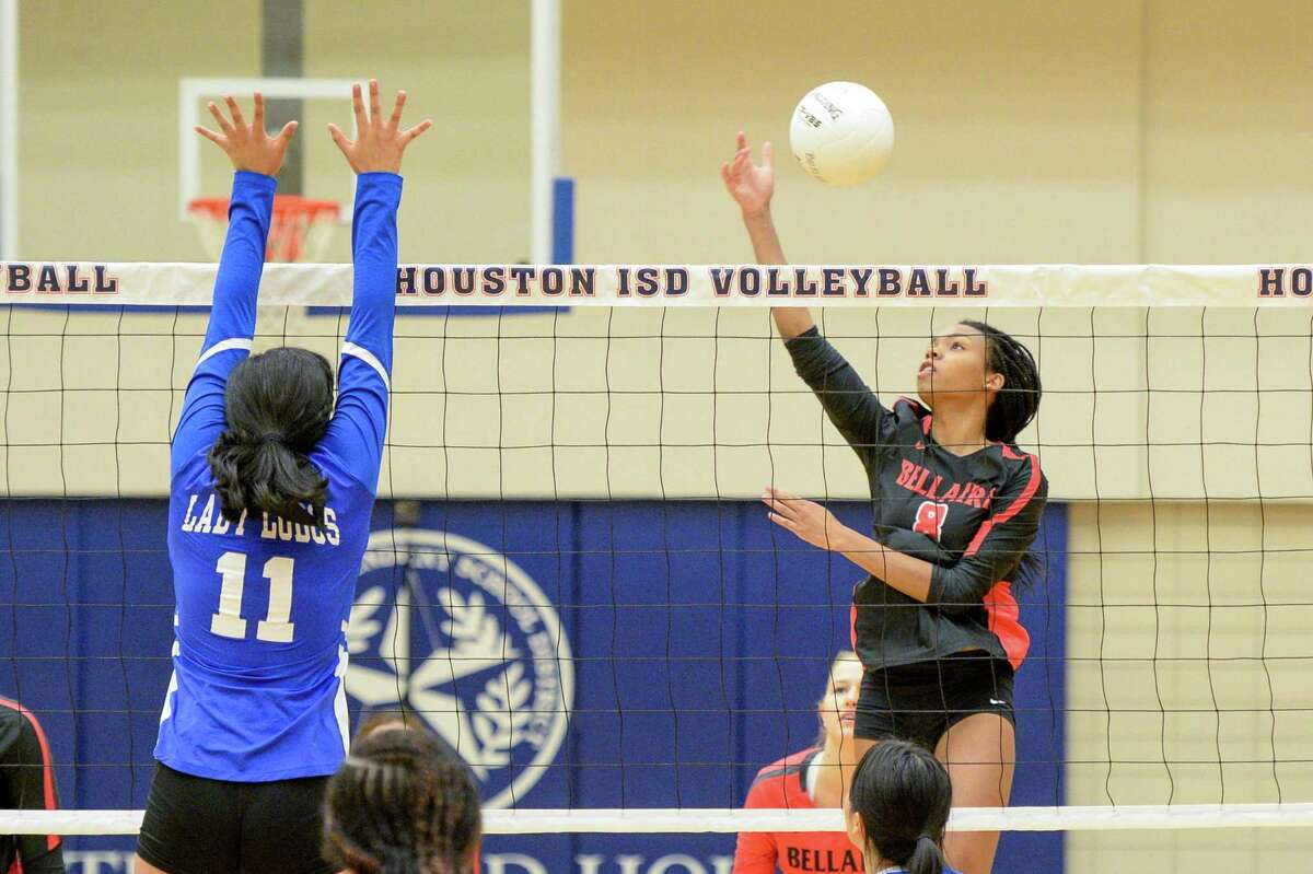 Spirit Martin (8) of Bellaire attempts a shot during the second set of a high school volleyball match between the Bellaire Cardinals and the Chavez Lobos on Tuesday, September 24, 2019 at Butler Fieldhouse, Houston, TX.