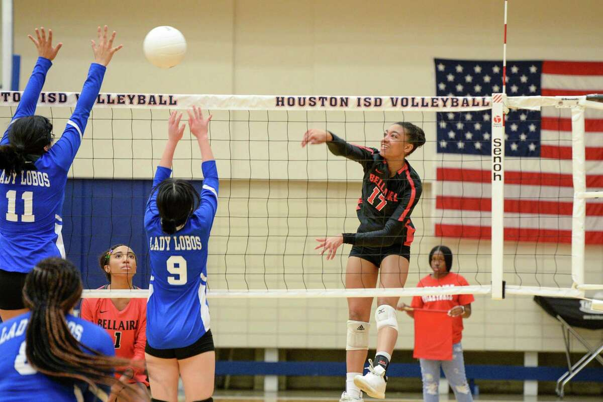 Clark Adams (17) of Bellaire attempts a kill shot during the third set of a high school volleyball match between the Bellaire Cardinals and the Chavez Lobos on Tuesday, September 24, 2019 at Butler Fieldhouse, Houston, TX.