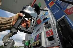 A woman pumps gas at a gas pump at a convenience store in Pittsburgh Monday, Sept. 16, 2019. (AP Photo/Gene J. Puskar)