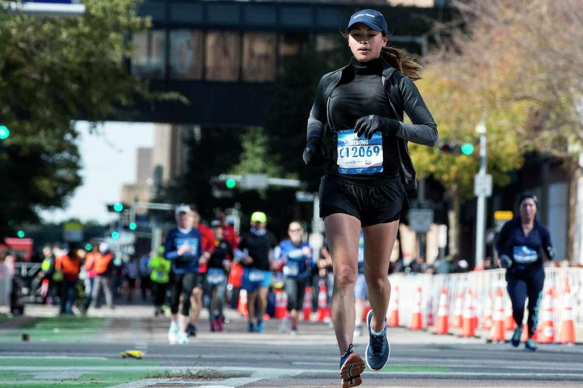 Stephanie Rebong turns the corner to the final stretch toward the finish line of the Chevron Houston Marathon on Sunday, Jan. 20, 2019, in Houston.