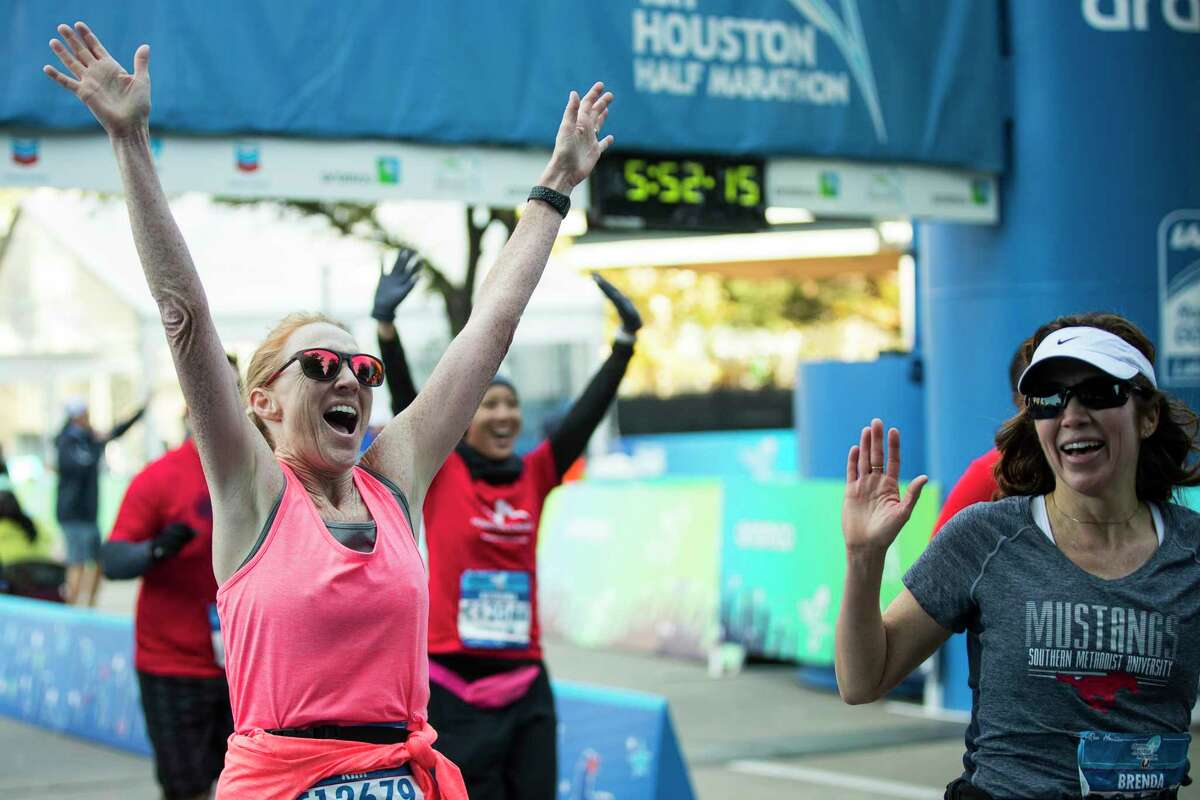 Kimberly Voelkel celebrates as she crosses the finish line of the Chevron Houston Marathon on Sunday, Jan. 20, 2019, in Houston.