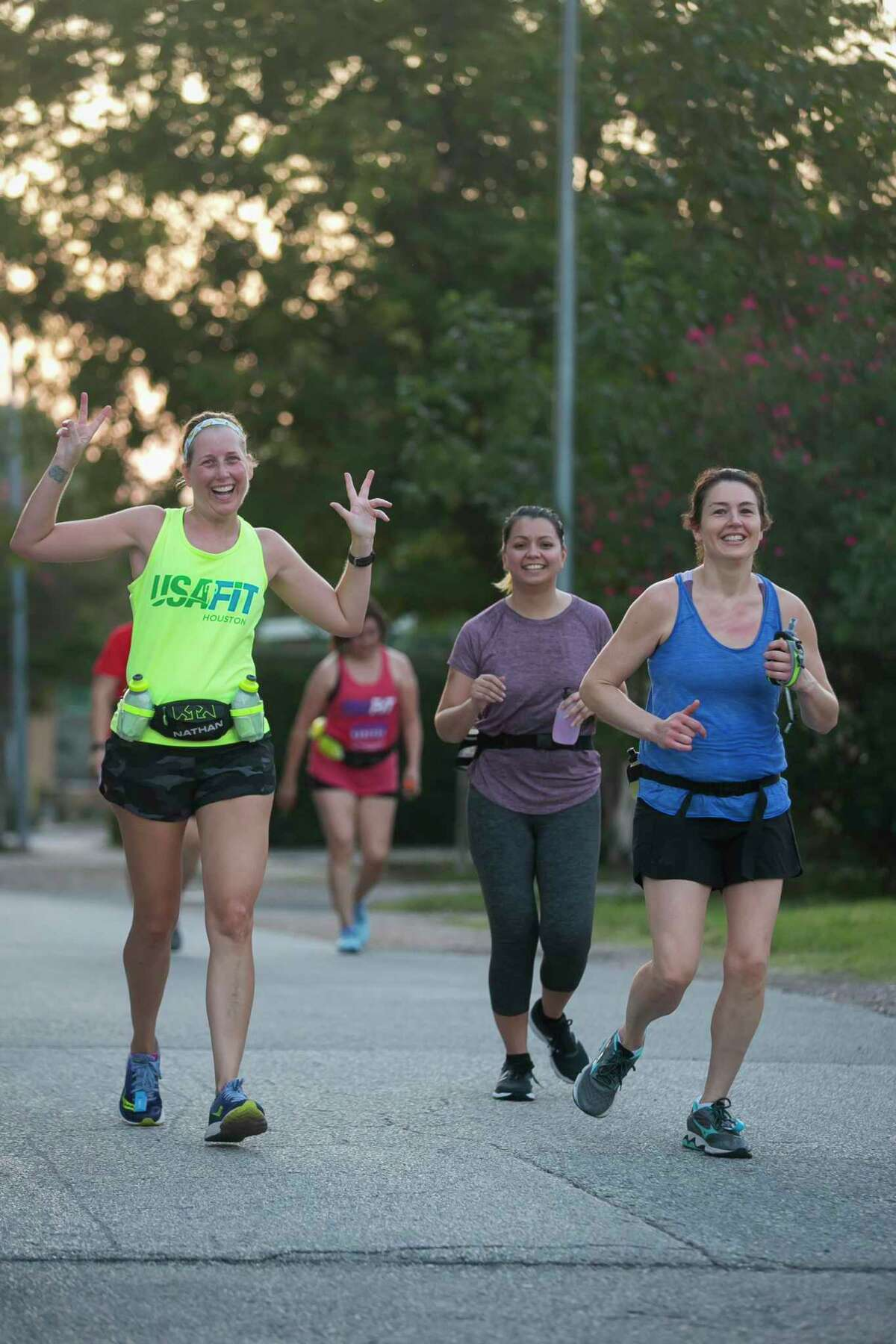 A group of runners during a morning jog on Saturday, Sept. 14, 2019, in Houston.