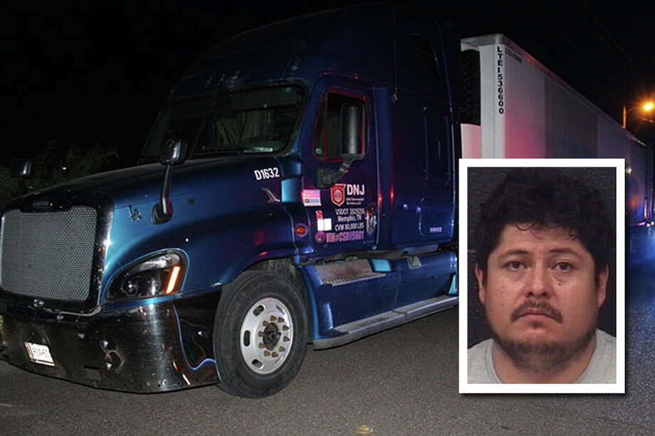A truck driver was arrested after Laredo police officers discovered 41 undocumented immigrants inside his refrigerated trailer, authorities said Wednesday. Photo: Courtesy