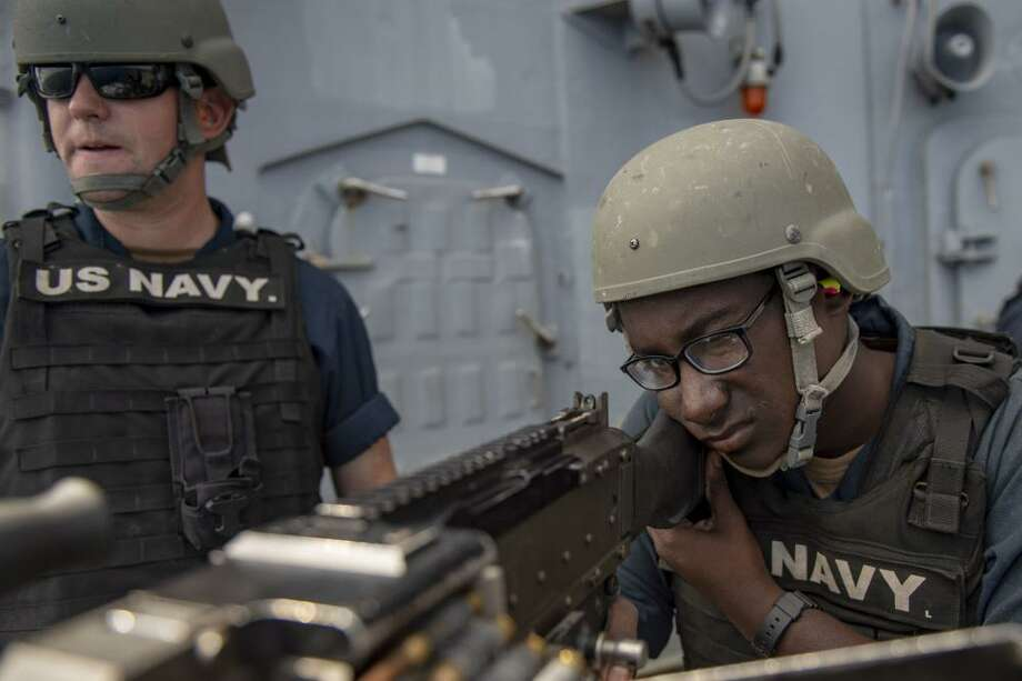 ATLANTIC OCEAN — Seaman Jaison Livingston, from Houston, fires a M-240B machine gun off the port side of the Ticonderoga-class guided-missile cruiser USS Vella Gulf (CG 72). Vella Gulf is underway conducting routine training exercises in the Atlantic Ocean. Photo: Mass Communication Specialist 3rd Class Gian Prabhudas / U.S. Navy