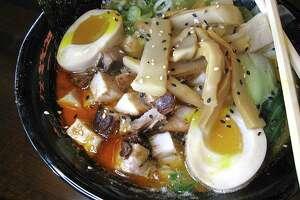 Spicy umami miso is a pork broth ramen with diced pork, seasoned egg, bok choy and an add-on of bamboo shoots at Bakudan Ramen.