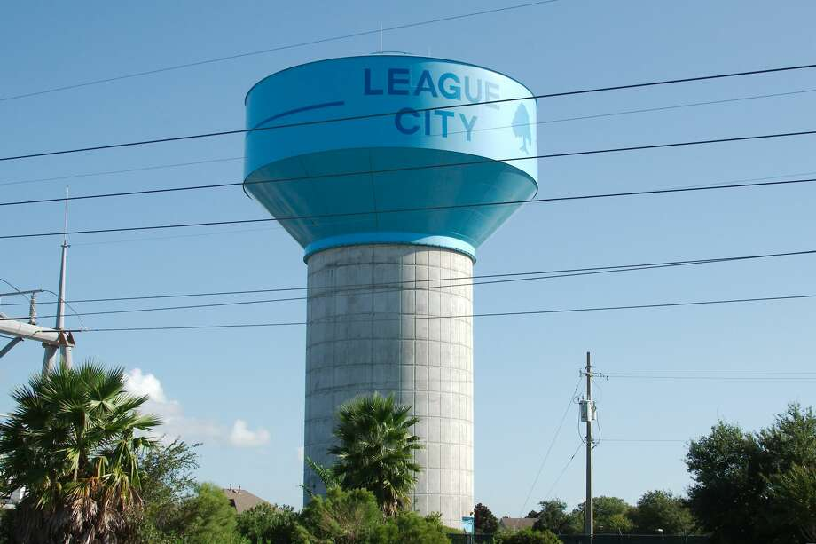 League City's council approved an insurance check for $205,660 to cover damages caused by a leak at this water tower. The water damaged an elevator and some equipment in a fire station temporarily based beneath the structure. Photo: Kirk Sides/Staff Photographer