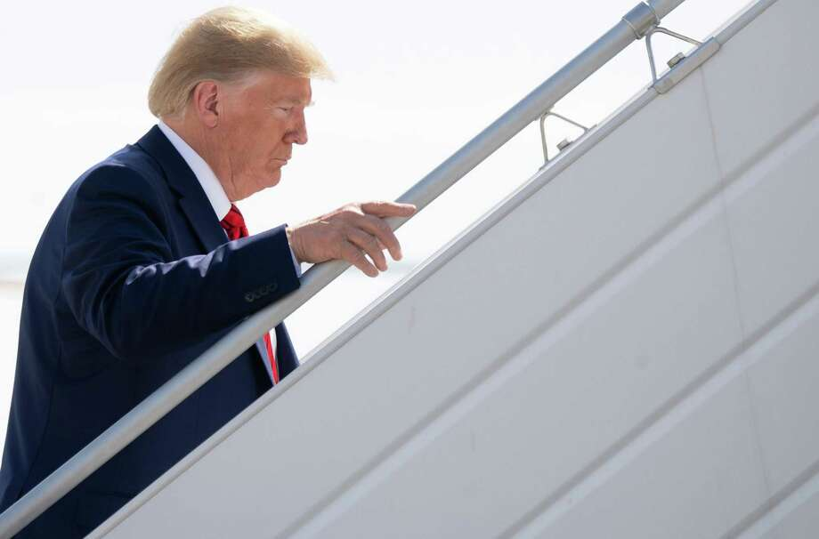 President Donald Trump boards Air Force One prior to departure from John F. Kennedy International Airport in New York on Thursday. Photo: Getty Images / AFP or licensors