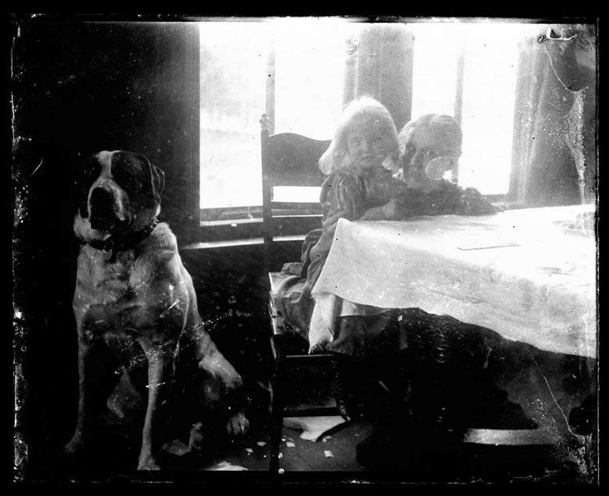 A young Sigrid Schultz at a dining room table in her family's home in Chicago. Photos of Sigrid's family were found by Jimmy Nuter while he did architectural salvage work on an old farmhouse on North Wolcott Avenue in Chicago.
