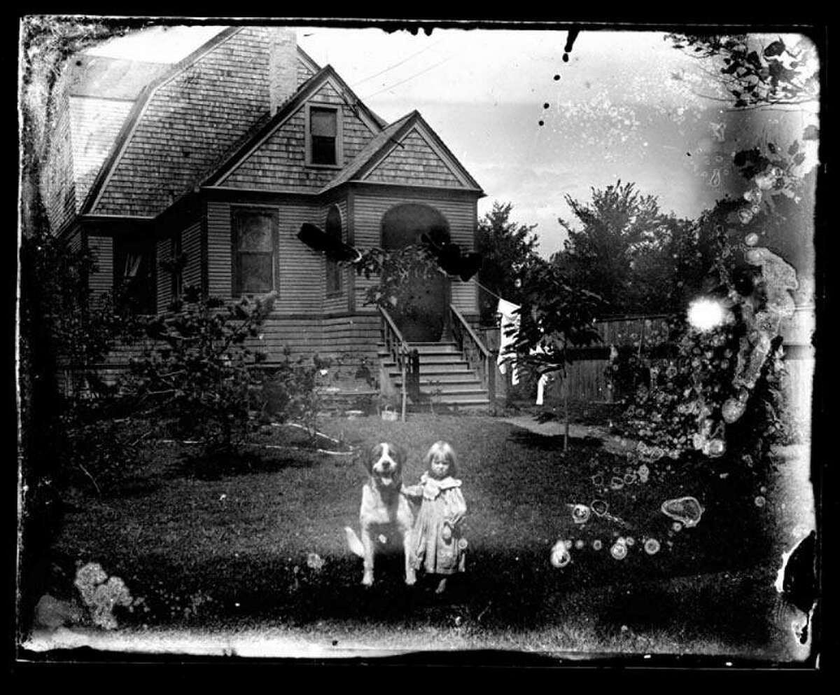 A young Sigrid Schultz with her dog at her family's house in Chicago. Photos of Sigrid's family were found by Jimmy Nuter while he did architectural salvage work on an old farmhouse on North Wolcott Avenue in Chicago.