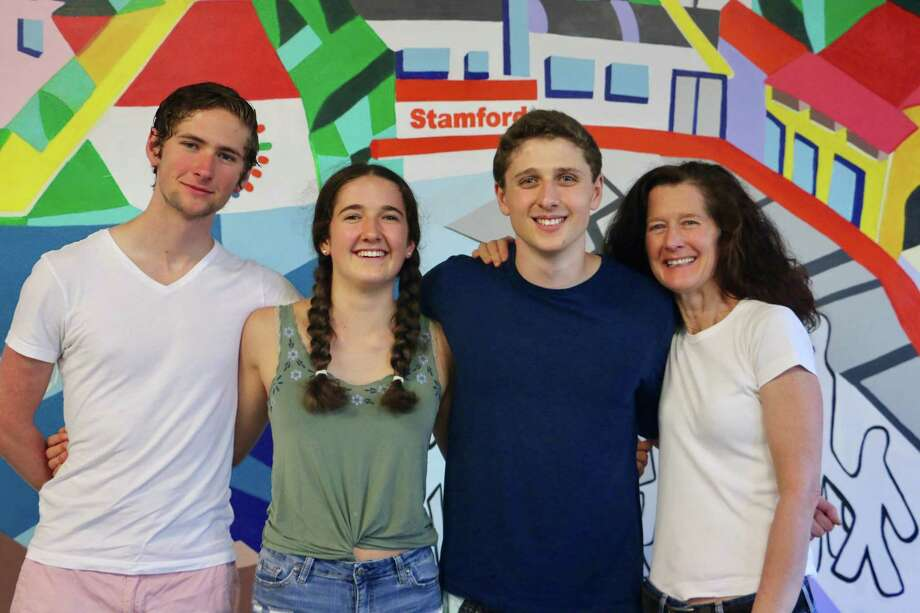 The Russell family of Darien. From left, Aram, Maggie, Liam, Holly. They all volunteer at Building One Community in Stamford. Photo: Contributed Photo / Connecticut Post